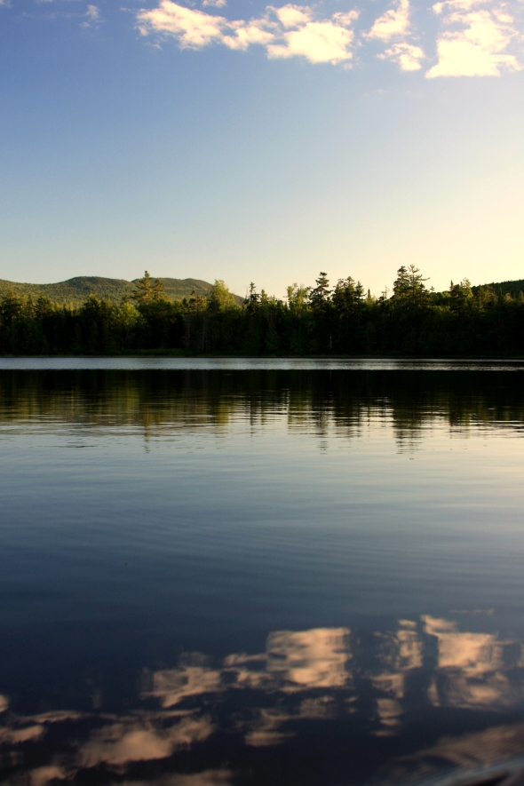 reflections on west branch pond, maine